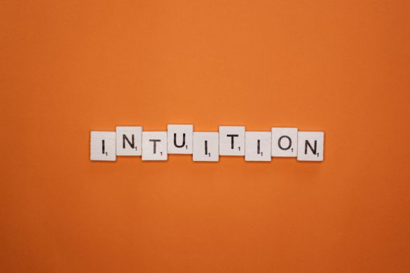 Intuition scrabble letters word on a orange background